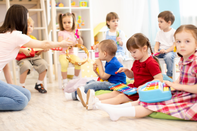 junior preschool kids playing instruments